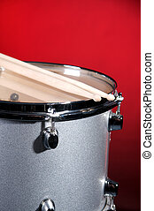 Silver Tom Drum Isolated On Red - A silver sparkle tom drum...