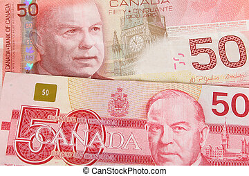 Old and new Canadian fifty dollar notes