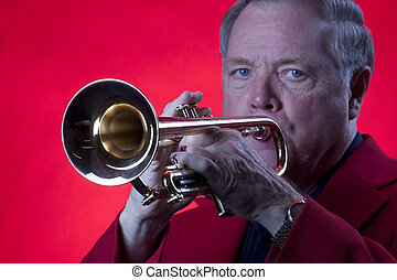 Musician Playing Trumpet Isolated on Red
