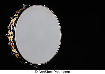 Tambourine Isolated On Black - A tambourine isolated against...