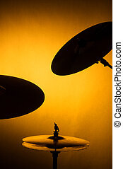Silhouette of Cymbals Isolated on Gold - A set of drum...
