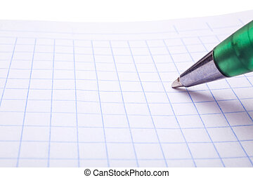 Pen and notebook into the cell closeup