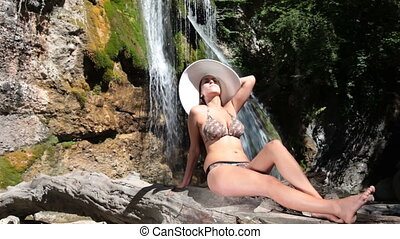 sunbathing near the waterfall