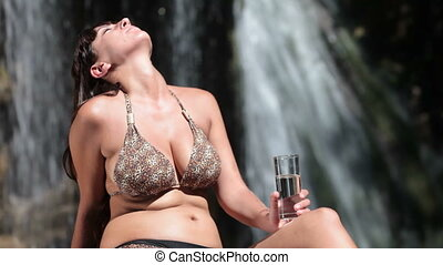 drinking fresh water - woman in bikini drinking fresh water...