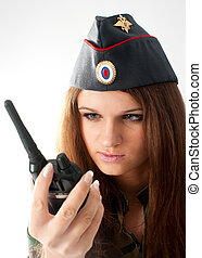 Sexy girl with radio set - Sexy young woman in army uniform...