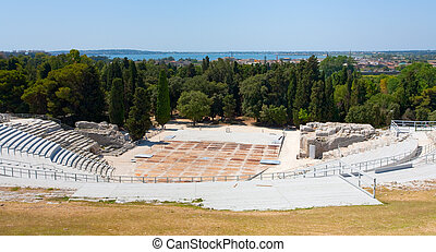 antique Greek Theater and Ionian Sea, Sicily - view on...