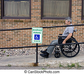 wheelchair ramp - man in a wheelchair on a handicapped...