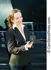 Businesswoman with a mobile phone - Businesswoman holding a...
