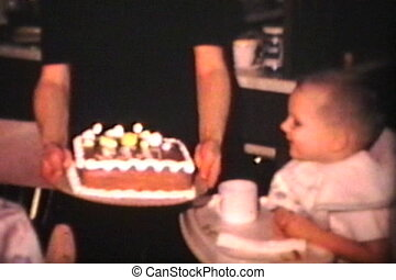 Birthday Boy Blows Out Candles 1965 - A cute little boy...