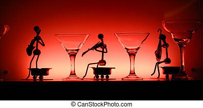 Glasses and statuettes in red light - Wineglasses and...