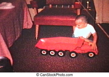Boy Plays With Truck And Tractor