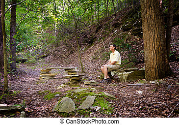 Senior hiker in woods in Virginia