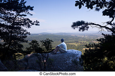 Senior hiker overlooks Virginia - Retired hiker on top of...