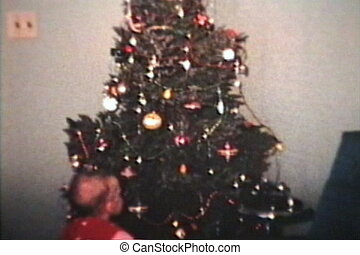 Boy With Christmas Tree 1962 - A cute little boy wearing a...
