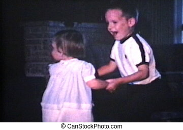 Brother And Sister Dancing 1966 - A boy dances with his cute...