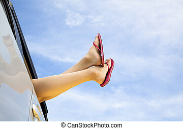 young womans legs and summer road trip concept
