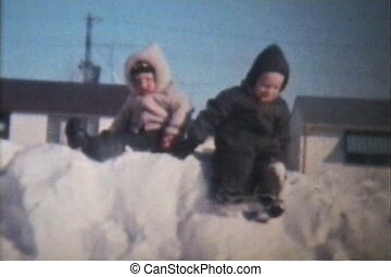 Brothers Playing In The Snow 1966 - Two cute brothers swing...