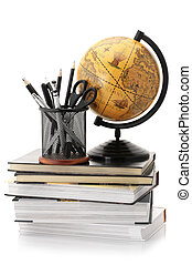 Globe, books and office supplies - Vintage globe on stack of...