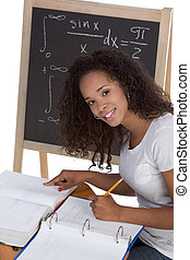 ethnic black college student woman studying math exam - High...