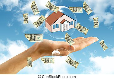 Money  and house in hand