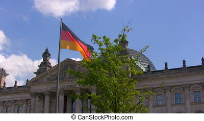 German flag near Reichstag, Berlin - National German flag...