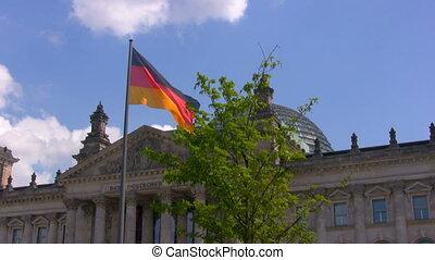 German flag near Reichstag, Berlin - National German flag...