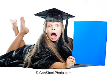 Portrait of cute girl in black academic cap with liripipe and gown reading big blue book on isolated white