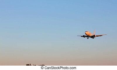 Landing of Jetime airplane, sunset scene, Corfu airport,...
