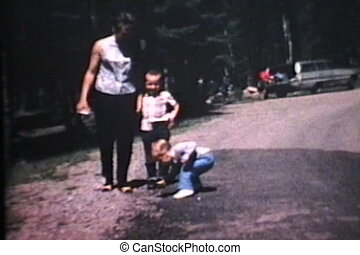 Family Vacation In Cabin 1967 - A young mother and father...