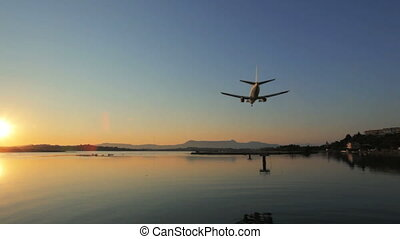 Landing of airplane, sunset scene, Corfu airport, Greece...