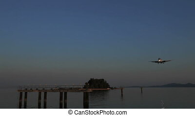 Landing of Thomson airplane, sunset scene, Corfu airport,...