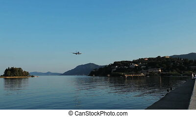 Landing of Travel service airplane, sunset scene, Corfu...