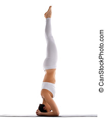 Yong woman exercise yoga supported headstand - young woman...