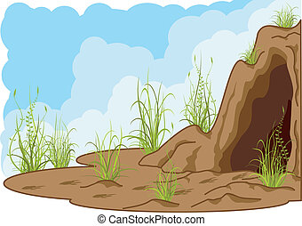 landscape with cave, grass and tracks of smb.