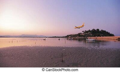 Landing of Thomson airplane, sunset scene, Corfu airport,...