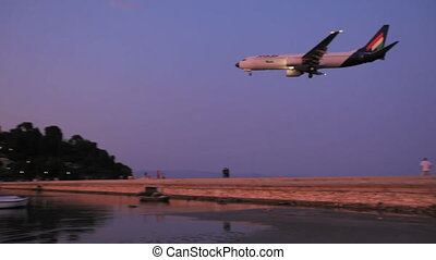 Landing of Malev airplane, night scene, Corfu airport,...