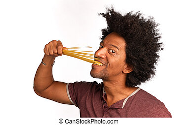 Al dente - Biting in a bunch of spaghetti, concept for al...