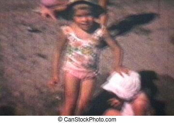 Kids At The Beach (1969 Vintage) - Three cute siblings enjoy...