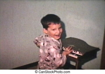 Kids Play Toy Piano (1968 Vintage) - A cute brother and...