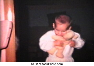Little Boy Cuddling Teddy Bear 1963 - A cute little boy hugs...