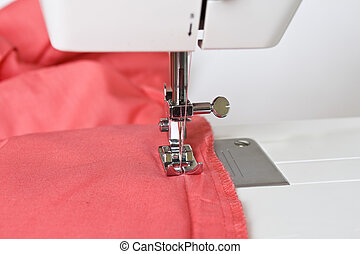 DIY sewing - close up of red cloth on the sewing machine