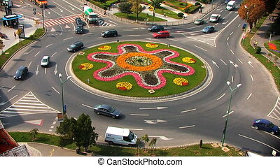 Roundabout Summer Time - cars going around a beautiful...