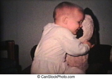 Little Boy Hugging Panda Bear 1963 - A cute little boy hugs...