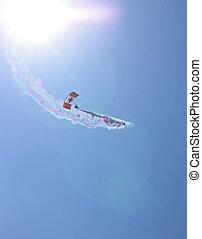 parachutist against the sun