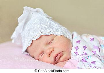 sweet newborns dreams - little newborn girl dreaming at home...