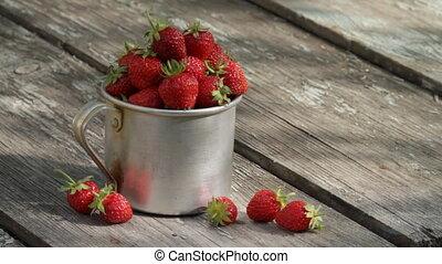 ripe strawberry - Aluminium mug full of ripe strawberry, is...