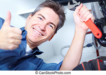 Plumber - Happy professional plumber doing sink reparation...