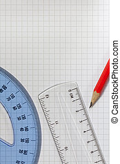 Pencil,Protractor and Ruler on squared paper