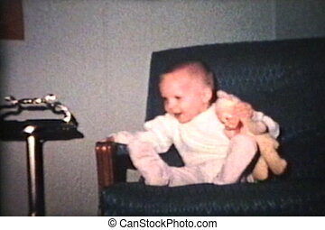 Little Boy In Big Rocking Chair - A cute little boy has a...