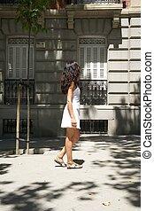 woman side walking on sidewalk